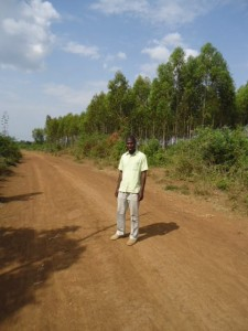 Victor walks for miles on the dusty roads to check on the families in Bondo.